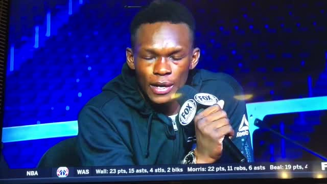 Israel Adesanya Calls Out Bisping, While Sitting Next To Him On Live